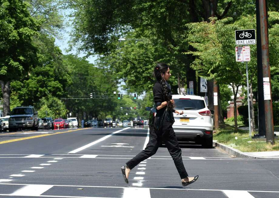 A pedestrian crosses Madison Ave. at S. Lake on Friday, June 29, 2018, in Albany, N.Y. Mayor Kathy Sheehan held a press conference to highlight the completion of the major components of the second and final phase of the Madison Avenue Street Calming project. (Will Waldron/Times Union) Photo: Will Waldron / 20044232A