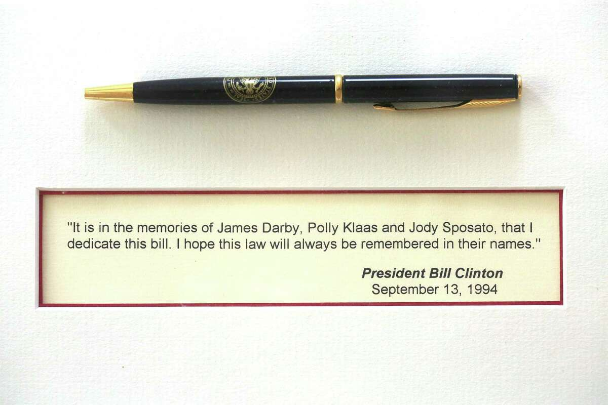 Stephen Sposato shows pen given to him by president Clinton after the passing of the 1994 Federal Assault Weapons Ban (AWB) which he shows in his living room on Thursday, June 14, 2018 in Lafayette, Calif. President Clinton mentions Sposato's significant role in passage of assault weapons ban as he listened to Stephen talk of his tragedy while holding his child Meghan beside him.