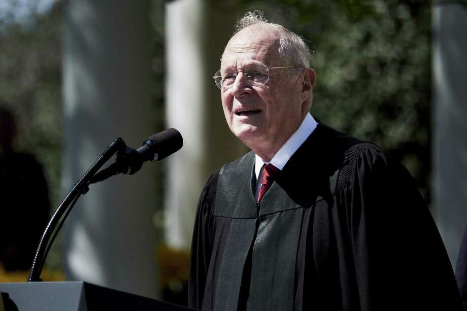 Supreme Court Justice Anthony Kennedy speaks before administering the oath of office to Judge Neil Gorsuch in the White House Rose Garden on April 10, 2017. Photo: T.J. Kirkpatrick / Bloomberg / Bloomberg