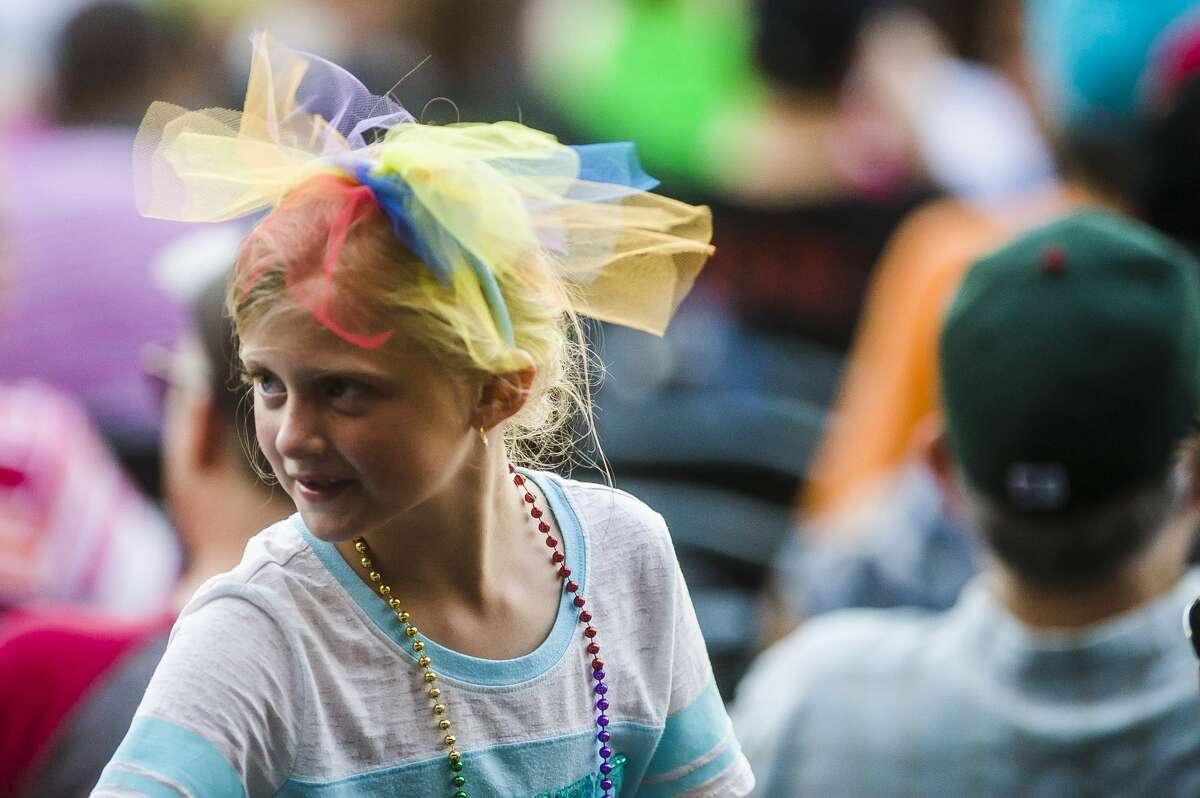 Hannah Lundquist of South Lyon, 7, wears rainbow colors in her hair celebration of pride night at Dow Diamond during the Loons' game against the Lansing Lugnuts on Friday, June 29, 2018. (Katy Kildee/kkildee@mdn.net)