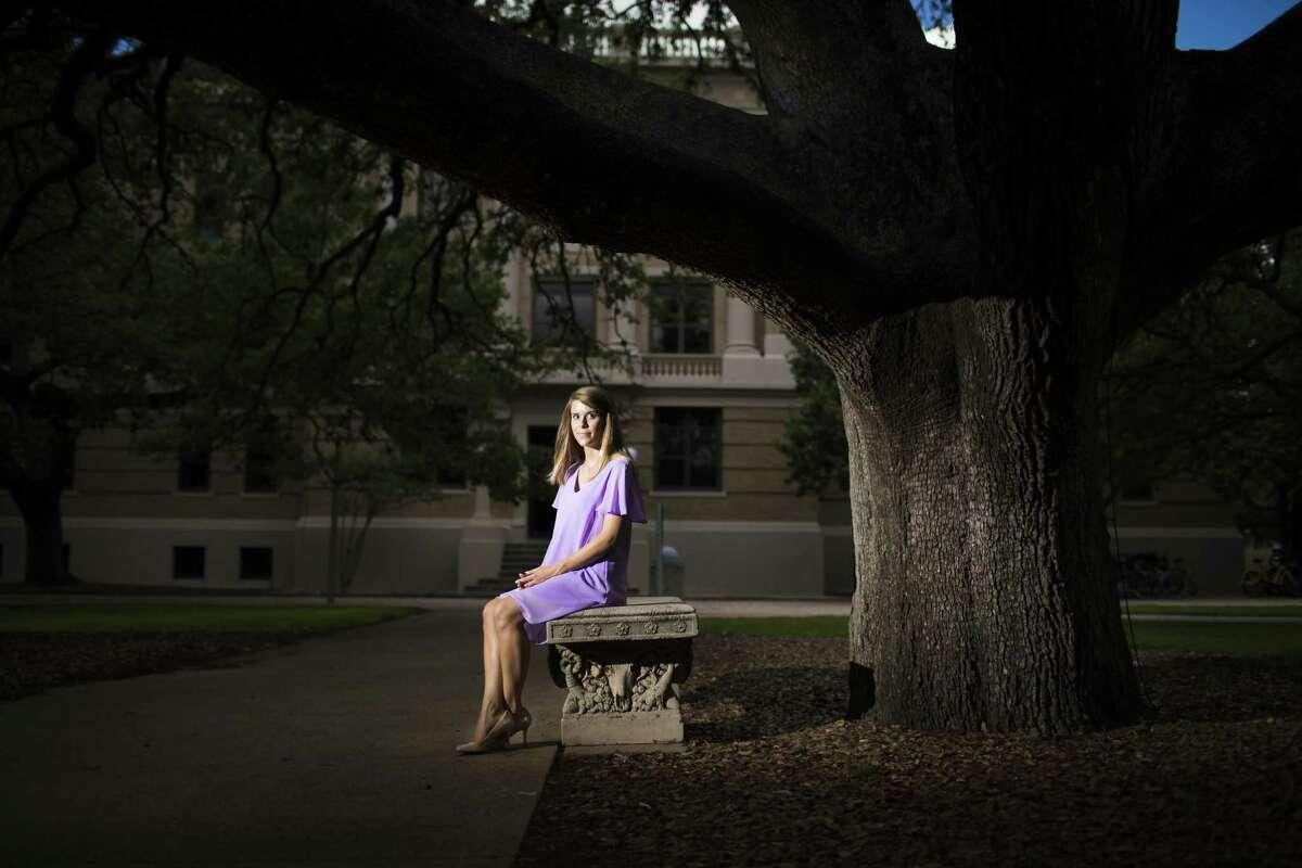 Texas A&M University student Nicole Platamone sits under the Century Tree, Thursday, June 28, 2018, in Houston.