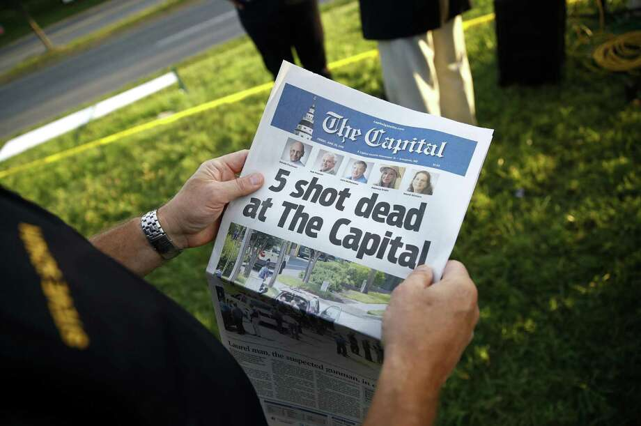 Steve Schuh, county executive of Anne Arundel County, holds a copy of The Capital Gazette near the scene of a shooting at the newspaper's office, Friday, June 29, 2018, in Annapolis, Md. A man armed with smoke grenades and a shotgun attacked journalists in the building Thursday, killing several people before police quickly stormed the building and arrested him, police and witnesses said. (AP Photo/Patrick Semansky) Photo: Patrick Semansky, STF / Associated Press / Copyright 2018 The Associated Press. All rights reserved.