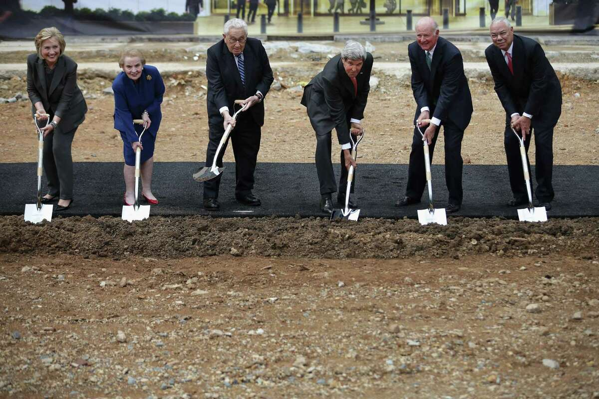 WASHINGTON, DC - SEPTEMBER 03: Secretary of State John Kerry (3R) leads former secretaries of state (L-R) Hillary Clinton, Madeleine Albright, Henry Kissinger, James Baker and Colin Powell in a ceremonial groundbreaking for the future U.S. Diplomacy Center at the State Department's Harry S. Truman Building September 3, 2014 in Washington, DC. When completed, the Diplomacy Center will be a museum and education center that will 'demonstrate the ways in which diplomacy matters now and has mattered throughout American history.' (Photo by Chip Somodevilla/Getty Images) *** BESTPIX ***