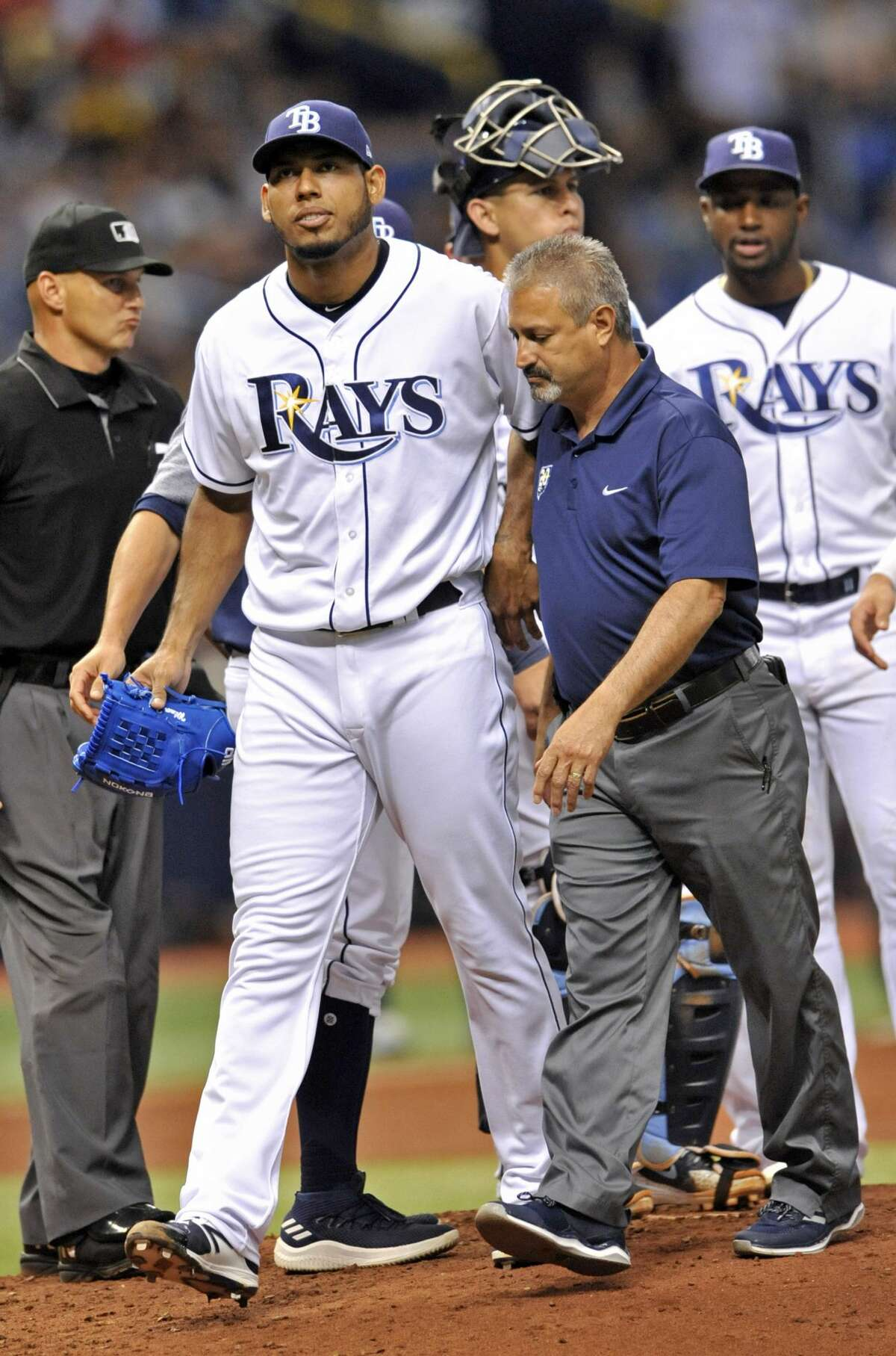 Tampa Bay Rays starter Wilmer Font leaves the game with a Tampa Bay trainer, while pitching to Houston Astros' Alex Bregman during the sixth inning of a baseball game Friday, June 29, 2018, in St. Petersburg, Fla. (AP Photo/Steve Nesius)