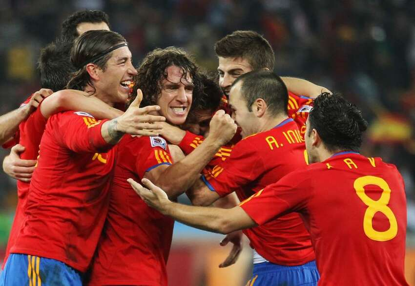 DURBAN, SOUTH AFRICA - JULY 07: Spain team mates celebrate the opening goal scored by Carles Puyol during the 2010 FIFA World Cup South Africa Semi Final match between Germany and Spain at Durban Stadium on July 7, 2010 in Durban, South Africa. (Photo by Joern Pollex/Getty Images) *** Local Caption *** Carles Puyol
