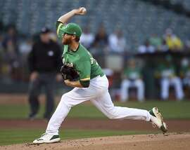 Oakland Athletics pitcher Paul Blackburn works against the Cleveland Indians in the first inning of a baseball game Friday, June 29, 2018, in Oakland, Calif. (AP Photo/Ben Margot)