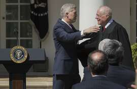 EDS. RETRANSMISSION OF XNYT100 SENT JUNE 27, 2018 TO CORRECT BYLINE  **** Supreme Court Justice Anthony Kennedy, right, administers an oath of office to Justice Neil Gorsuch, at the Rose Garden of the White House in Washington, April 10, 2017. Kennedy, who has long been the decisive vote in many cases, announced his intent to retire on June 27, 2018, setting the stage for a furious fight over the future direction of the Supreme Court. (Stephen Crowley/The New York Times)