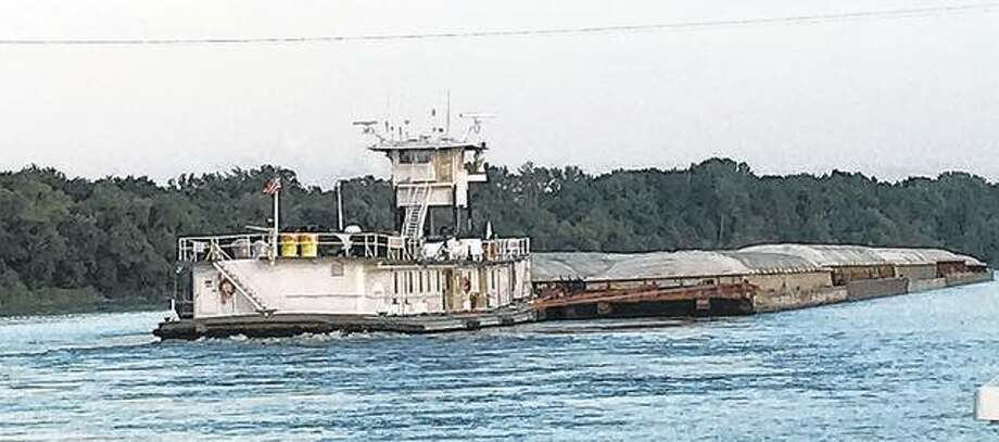 A tugboat goes about its business on the Illinois River.