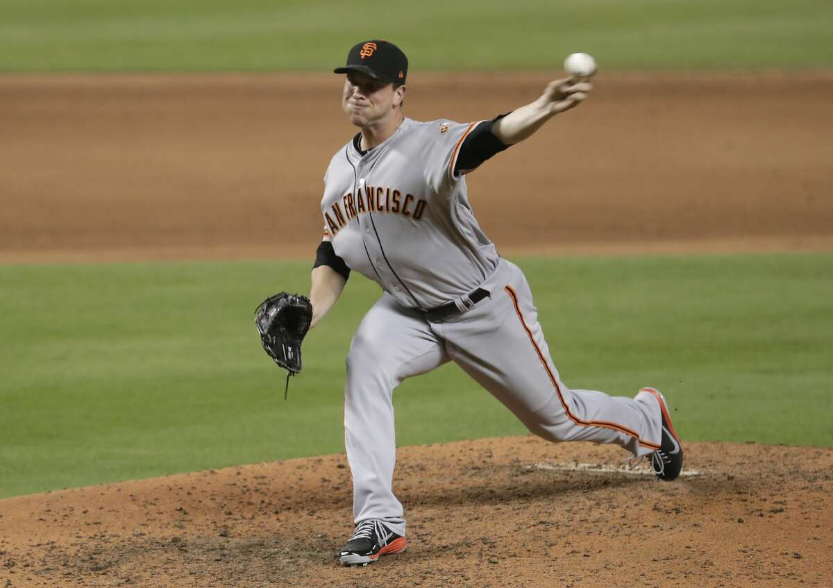 San Francisco Giants relief pitcher Tony Watson delivers during the eighth inning of a baseball game against the Miami Marlins, Thursday, June 14, 2018, in Miami. The Giants won 6-3 in sixteen innings. (AP Photo/Lynne Sladky)
