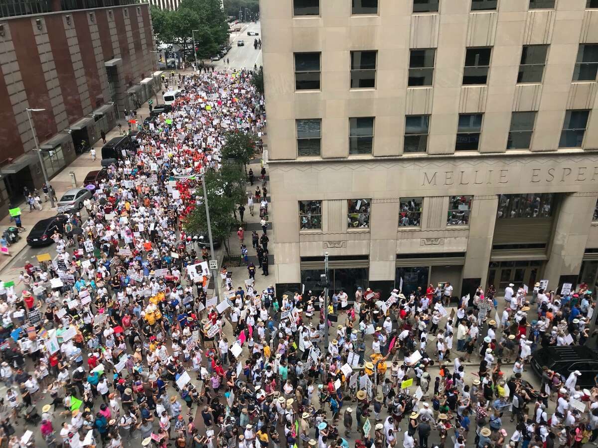 Protesters at the National Day of Action-Families Belong Together march in Houston converge on U.S. Sen. Ted Cruz's office from city hall on Saturday, June 30, 2018.