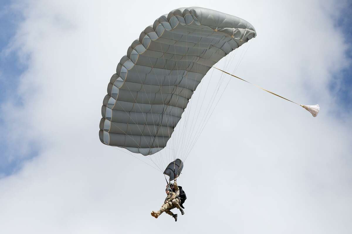 Members of the 350th Battlefield Airmen Training Group parachute in tandem from a freefall jump for the crowd as the San Antonio-based Recruiting Service at JBSA Lackland stands up the 330th Special Operations Recruiting unit following a week of training at the new Battlefield Airmen Prep course on Friday, June 29, 2018. MARVIN PFEIFFER/mpfeiffer@express-news.net