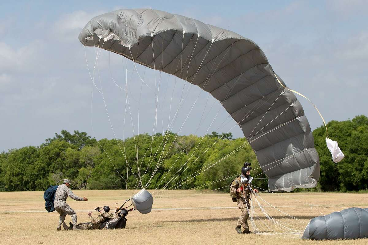 Members of the 350th Battlefield Airmen Training Group land on the infield after parachuting from a freefall jump for the crowd as the San Antonio-based Recruiting Service at JBSA Lackland stands up the 330th Special Operations Recruiting unit following a week of training at the new Battlefield Airmen Prep course on Friday, June 29, 2018. MARVIN PFEIFFER/mpfeiffer@express-news.net