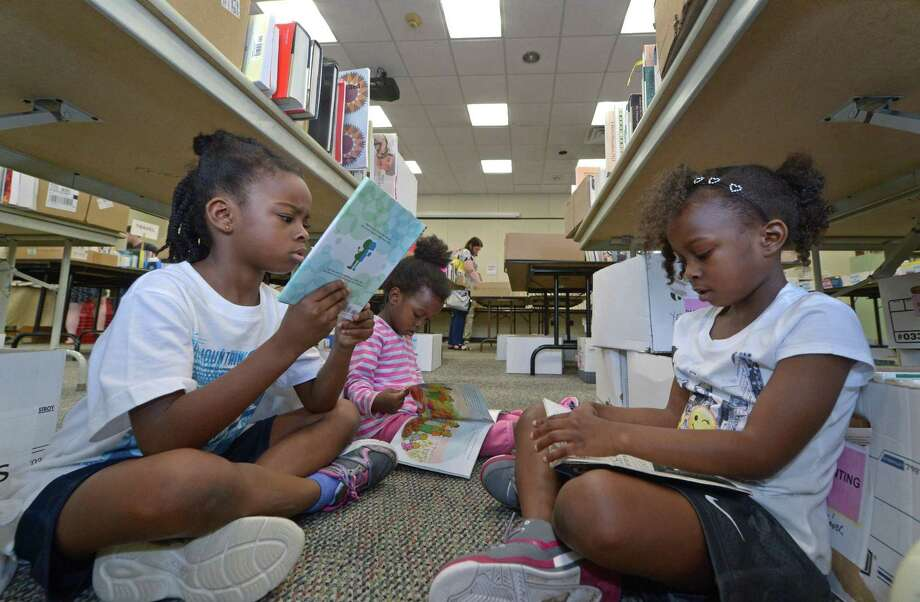 Libraries are a great place to beat the heat. Photo: Erik Trautmann / Hearst Connecticut Media / Norwalk Hour