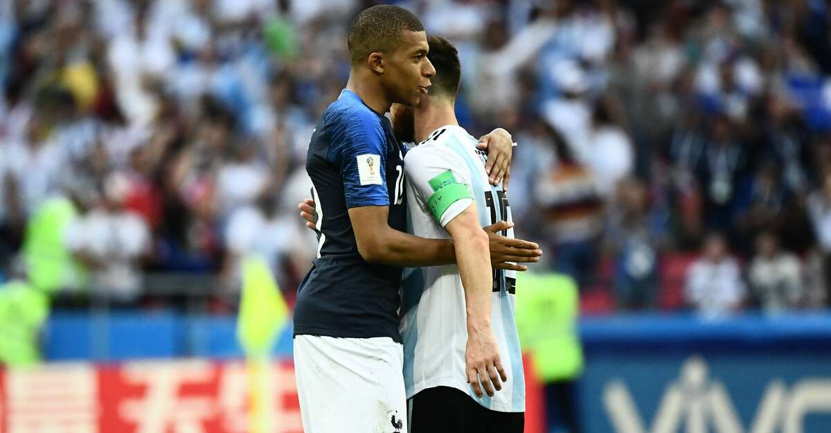 France's forward Kylian Mbappe (L) greets Argentina's forward Lionel Messi at the end of the Russia 2018 World Cup round of 16 football match between France and Argentina at the Kazan Arena in Kazan on June 30, 2018. / AFP PHOTO / Jewel SAMAD / RESTRICTED TO EDITORIAL USE - NO MOBILE PUSH ALERTS/DOWNLOADSJEWEL SAMAD/AFP/Getty Images