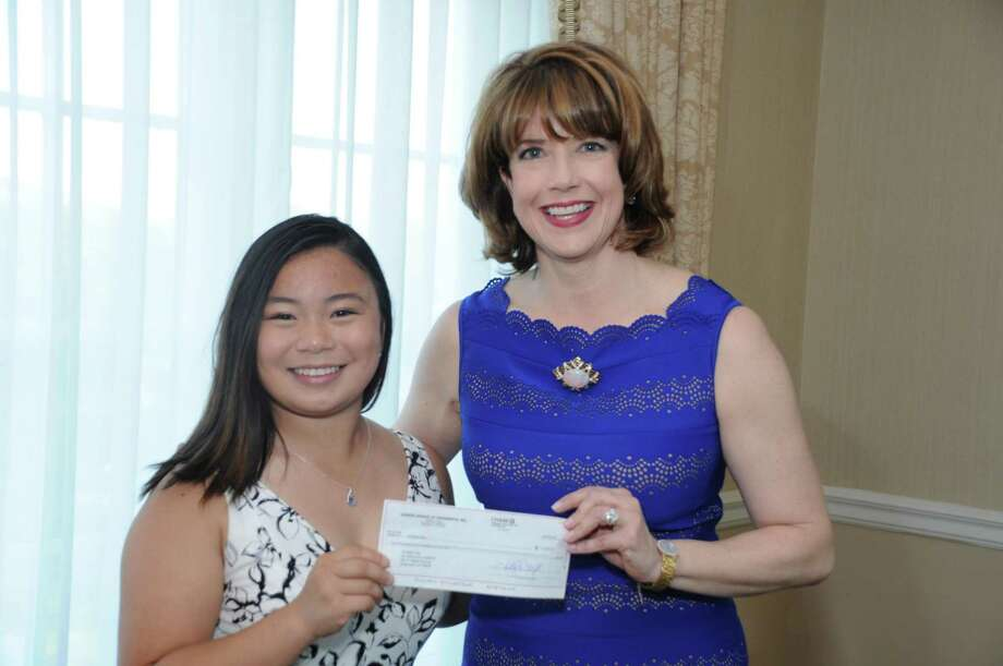 Recent Greenwich Academy graduate Christine Kao, who will be attending Georgetown University in the fall, recently received the Junior League of Greenwich's 2018 Community Service Award. League member Hilary Watson gives Kao a check for $2,500. Photo: Contributed /
