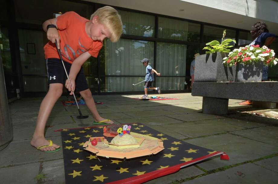 Ian Chase, 8, plays mini-golf during the Wilton Library Summer Reading Kick-Off Friday, June 29, 2018, in Wilton, Conn. Photo: Erik Trautmann / Hearst Connecticut Media / Norwalk Hour