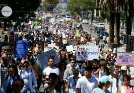 Thousands march on Market Street to a rally against President Trump's immigration policy at City Hall in San Francisco, Calif. on Saturday, June 30, 2018.
