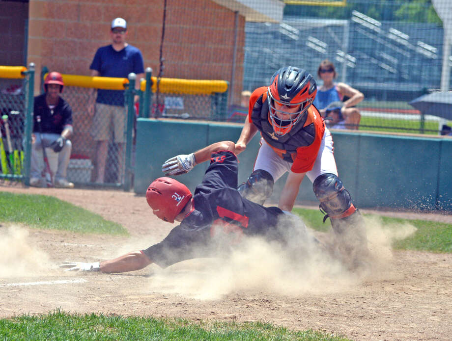 Edwardsville catcher Dalton Wallace, right, tags out St. Louis Prospects Black runner David Eklund on a play at the plate during the third inning of Saturday's game at Tom Pile Field.