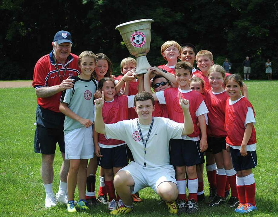 Every summer, the Packer Soccer Camp holds a World Cup competition with campers divided into countries. Here, camp founder and director Dick Packer (back row, far left) is seen with the winning team from a past year. Photo: Contributed Photo