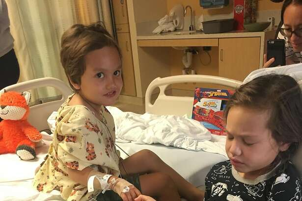 Four-year-old Noah Avery, left, holds hands with his sister, Kalea, 6, at Miller Children's and Women's Hospital Long Beach on Friday. Noah underwent brain surgery two days later. (Avery family)