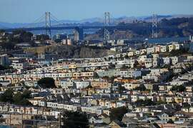 FILE � Houses near the Bay Bridge in picturesque, but prohibitively pricey, San Francisco, June 25, 2017. The federal government now classifies a family of four earning up to $117,400 as low-income in three counties around the Bay Area. (Jim Wilson/The New York Times)