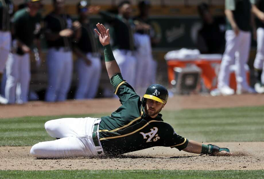 Oakland Athletics' Dustin Fowler scores on a a double by Mark Canha during the sixth inning of a baseball game against the Cleveland Indians, Saturday, June 30, 2018, in Oakland, Calif. (AP Photo/Marcio Jose Sanchez) Photo: Marcio Jose Sanchez / Associated Press
