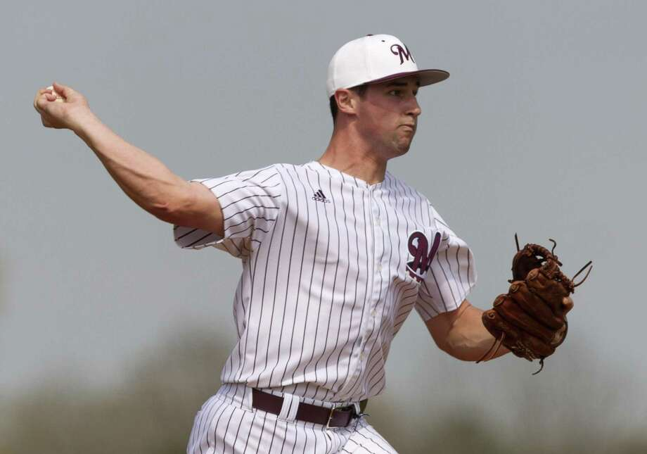 Magnolia starting pitcher Adam Kloffenstein tries to pickoff a runner at first in the second inning of a high school baseball game during the Montgomery-Brenham Tournament, Saturday, March 3, 2018, in Montgomery. Photo: Jason Fochtman, Staff Photographer / Houston Chronicle / © 2018 Houston Chronicle