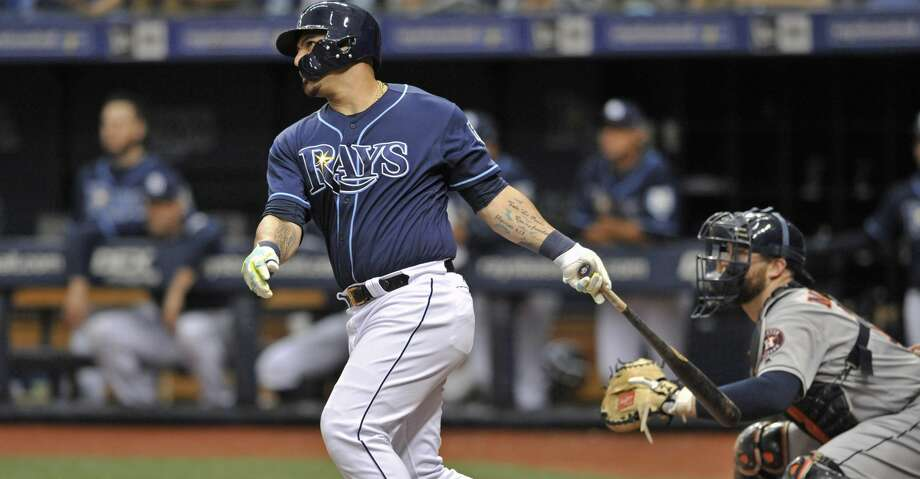 Houston Astros catcher Brian McCann, right, watches as Tampa Bay Rays' Wilson Ramos, left, hits a two-run double off Houston starter Justin Verlander during the first inning of a baseball game Saturday, June 30, 2018, in St. Petersburg, Fla. (AP Photo/Steve Nesius) Photo: Steve Nesius/Associated Press