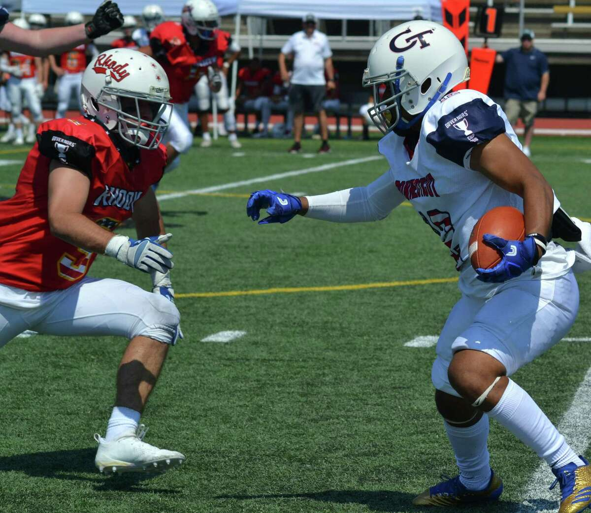 Connecticut's Chris Chance of West Haven looks to pick up extra yards against Rhode Island during Saturday's Governor's Cup in New Britain.