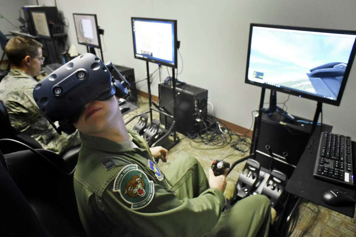 T-38 instructor pilot Josh Thomson uses a computer flight simulator at Joint Base San Antonio-Randolph. Thomson is assigned to the 560th Flying Training Squadron. , the Chargin' Cheetahs.