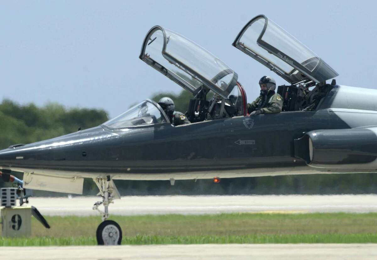 A T-38 Talon jet trainer crew taxis alongside a runway at Joint Base San Antonio-Randolph.