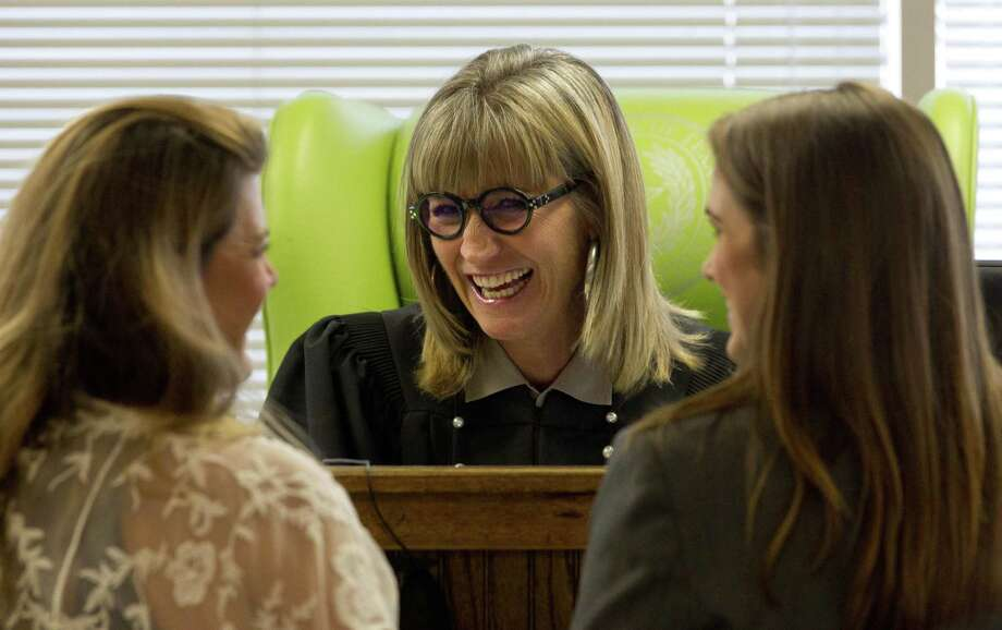 435th state District Court Judge Patty Maginnis shares a laugh as she visits before afternoon docket call on Thursday, June 28, 2018, in Conroe. Photo: Jason Fochtman, Staff Photographer / Houston Chronicle / © 2018 Houston Chronicle