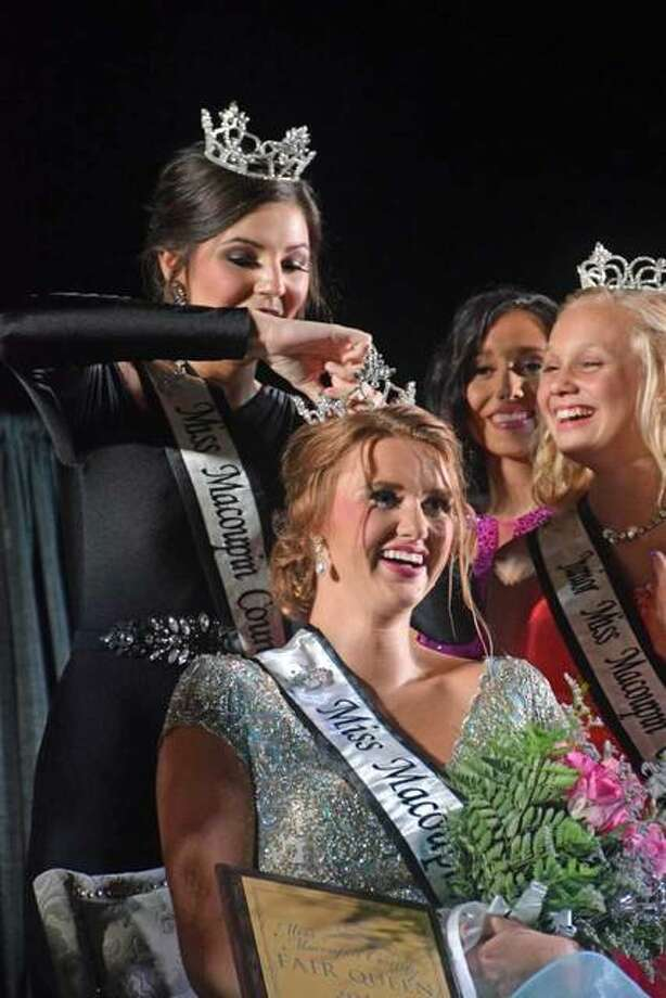 Anni Ibberson is crowned the 2018 Miss Macoupin County Fair last week by 2017 Queen Colleen Nichols. Photo:       David Blanchette | For The Telegraph