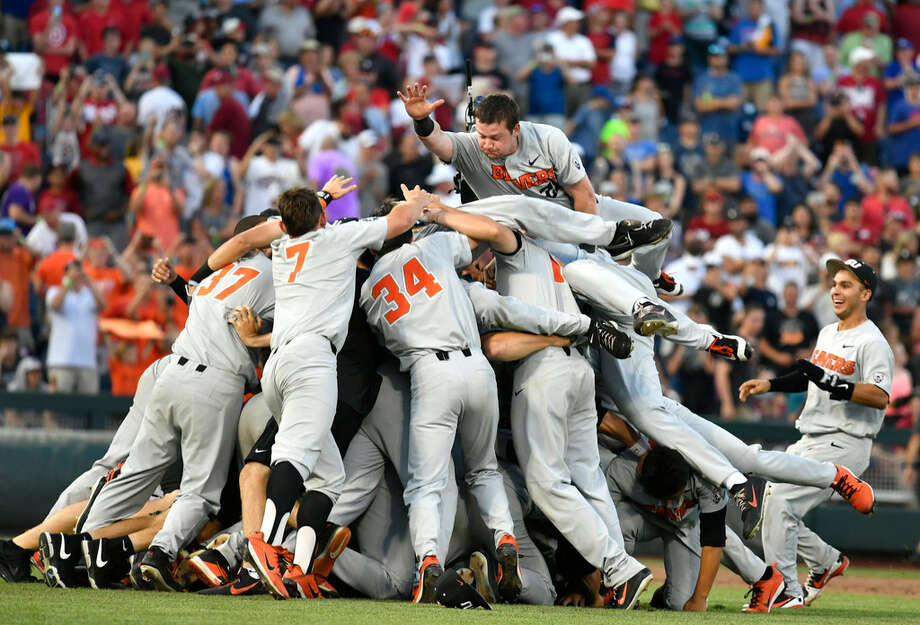 Oregon State players celebrates after winning Game 3 of the NCAA College World Series baseball finals in Omaha, Neb., Thursday, June 28, 2018. Oregon State defeated Arkansas 5-0. (AP Photo/Ted Kirk)