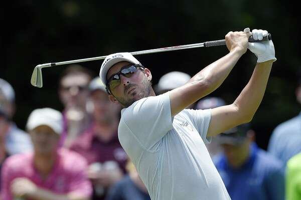 Andrew Landry watches his tee shot on the third hole during the third round of the Quicken Loans National golf tournament, Saturday, June 30, 2018, in Potomac, Md. (AP Photo/Nick Wass)
