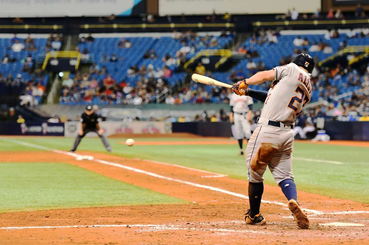 ST PETERSBURG, FL - JUNE 30: Jose Altuve #27 of the Houston Astros hits a single in the sixth inning against the Tampa Bay Rays on June 30, 2018 at Tropicana Field in St Petersburg, Florida. (Photo by Julio Aguilar/Getty Images)