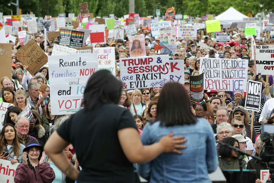 Several thousand demonstrators gathered outside the Federal Detention Center in SeaTac to protest the separation of families crossing the southern border and the Trump administration's immigration policies as part of a nationwide Families Belong Together day of action, June 30, 2018. Photo: GENNA MARTIN, SEATTLEPI.COM / SEATTLEPI.COM