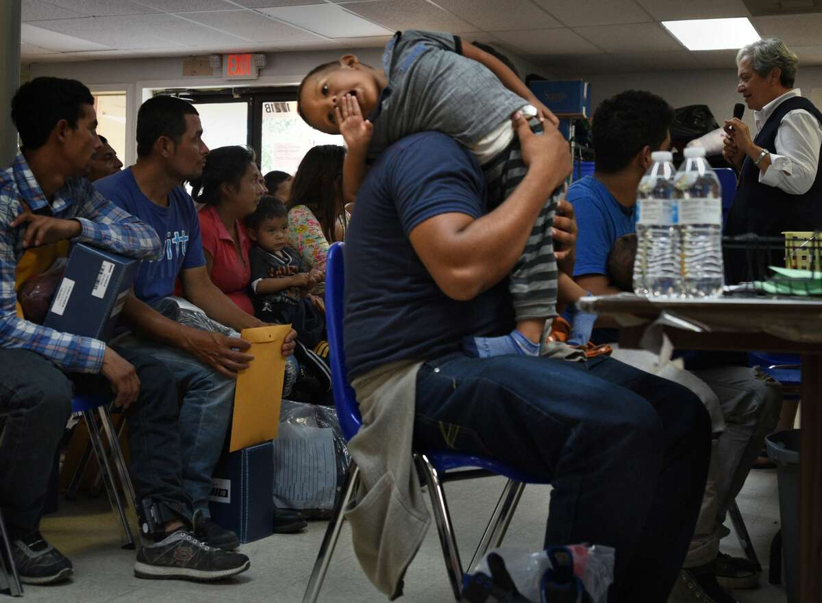 June 29, 2018 - McAllen, Texas - Catholic Charities of the Rio Grande Valley (CCRGV) with the help of the Sacred Heart Church, the City of McAllen, serves as a humanitarian respite center after immigrants are processed and released. They are given food, clothes, shoelaces which were taken from them, medical attention and welcoming warmth. Carol Guzy/ for San Antonio Express-News