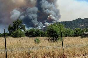 Smoke rises from a fire in Yolo County.