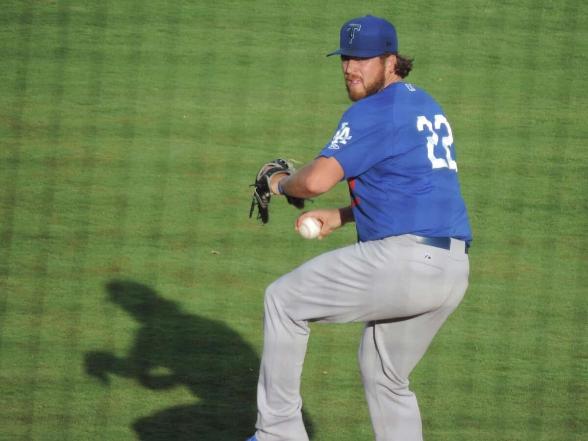Greenwood grad, former Midland College star and Tulsa Drillers pitcher Logan Bawcom delivers a pitch against the Midland RockHounds, Saturday at Security Bank Ballpark. Christopher Hadorn/Reporter-Telegram.