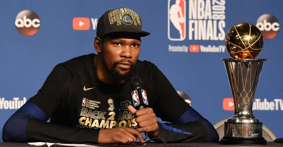 CLEVELAND, OH - JUNE 08:  Finals MVP Kevin Durant #35 of the Golden State Warriors speaks to the media after defeating the Cleveland Cavaliers during Game Four of the 2018 NBA Finals at Quicken Loans Arena on June 8, 2018 in Cleveland, Ohio. The Warriors defeated the Cavaliers 108-85 to win the 2018 NBA Finals.  NOTE TO USER: User expressly acknowledges and agrees that, by downloading and or using this photograph, User is consenting to the terms and conditions of the Getty Images License Agreement.  (Photo by Jason Miller/Getty Images) Photo: Jason Miller/Getty Images