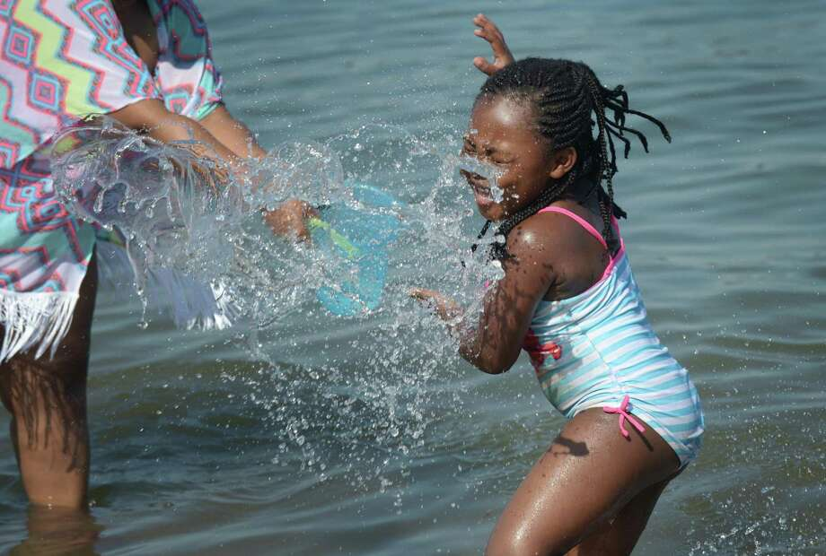 Aniya Strothers, 5,  beats the heat by playing in the water at Calf Pasture Beach Saturday, June 30, 2018, in Norwalk Conn. Photo: Erik Trautmann / Hearst Connecticut Media / Norwalk Hour