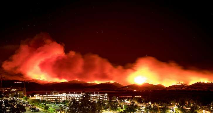 In this long exposure photo, fire burns behind Cache Creek Casino Resort near Guinda, California near on July 1, 2018.  Multiple wind-driven fires continue to whip through the region.  / AFP PHOTO / JOSH EDELSONJOSH EDELSON/AFP/Getty Images