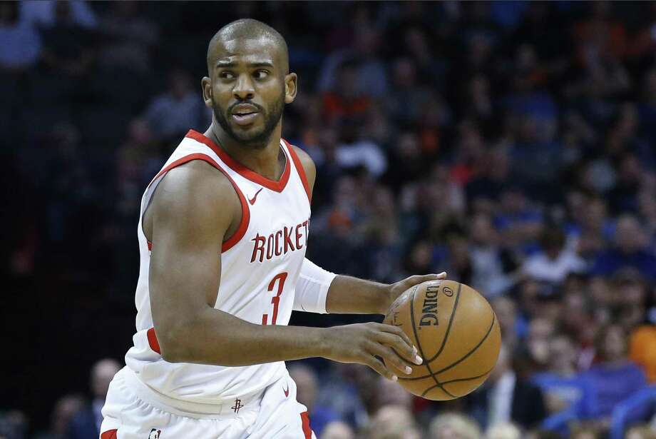 FILE - In this March 6, 2018, file photo, Houston Rockets guard Chris Paul moves the ball during the team's NBA basketball game against the Oklahoma City Thunder in Oklahoma City. Paul says he's staying with the Rockets. The star point guard wasted no time once the free agency window opened, and has decided to stay put with the team that finished last season with the NBA's best regular-season record. (AP Photo/Sue Ogrocki, File) Photo: Sue Ogrocki, STF / Associated Press / AP2018