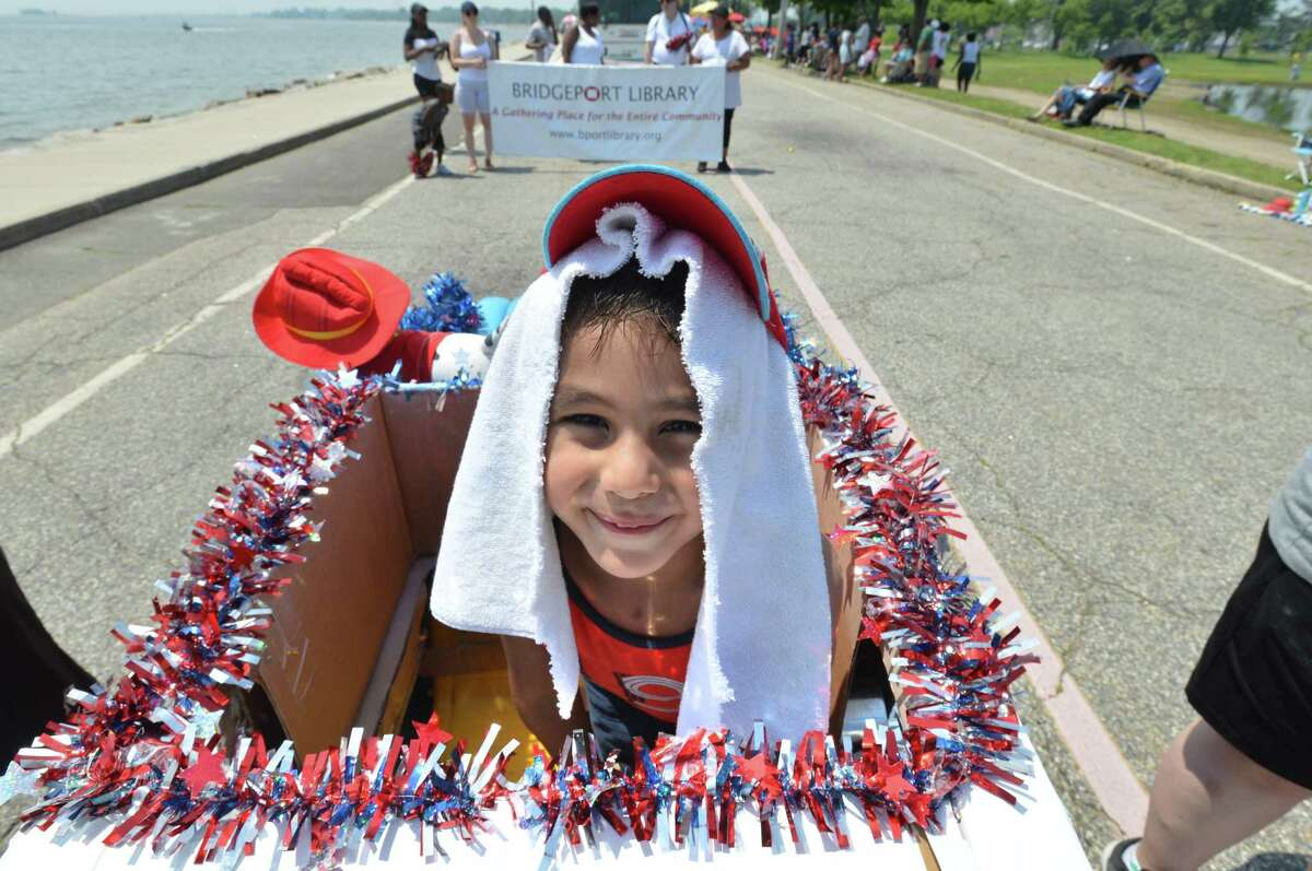 Bridgeport's Jorge Cevallos Jr. keeps cool in the parade behind the wheeli n his wing ding fire truck during the 2018 Barnum Festival Great Street Parade at Seaside Park on Sunday July 1 2018 in Bridgeport Conn.