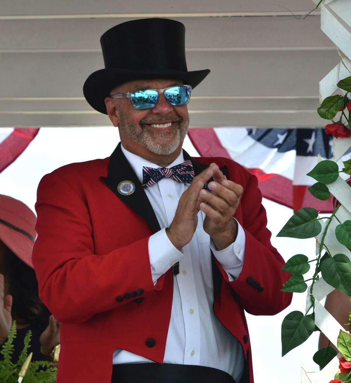 2018 Barnum Festival Ringmaster Johnny Vazzano applauds and waves to the crowd from his parade float during the 2018 Barnum Festival Great Street Parade at Seaside Park on Sunday July 1 2018 in Bridgeport Conn.