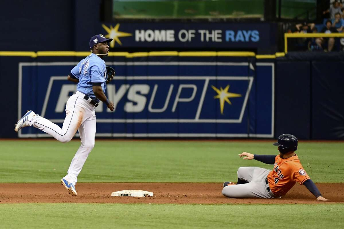 ST PETERSBURG, FL - JULY 1: Adeiny Hechavarria #11 of the Tampa Bay Rays gets a double play in the ninth inning against the Houston Astros on July 1, 2018 at Tropicana Field in St Petersburg, Florida. (Photo by Julio Aguilar/Getty Images)