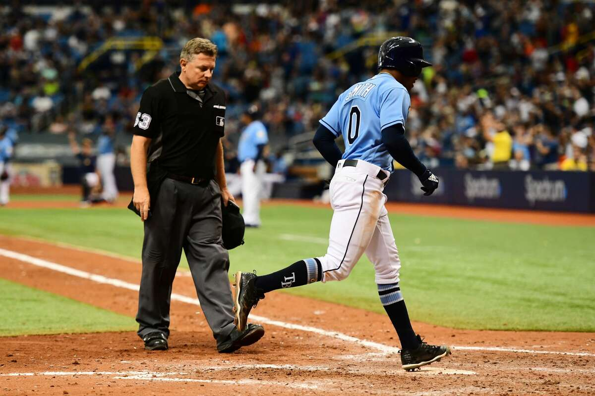 ST PETERSBURG, FL - JULY 1: Mallex Smith #0 of the Tampa Bay Rays steps on home plate after hitting a home run in the eighth inning against the Houston Astros on July 1, 2018 at Tropicana Field in St Petersburg, Florida. (Photo by Julio Aguilar/Getty Images)