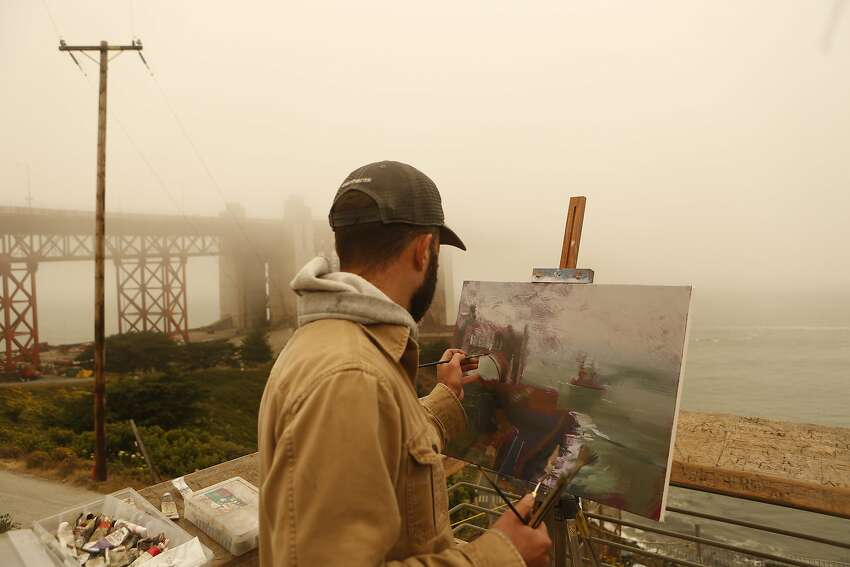 Andrew Walker Patterson, a professor of art from Redding Calif, paints the Golden Gate Bridge on Sunday, July 1, 2018 in San Francisco, Calif. Air quality in and around San Francisco has been visibly affected by the fires through the weekend. Patterson is on summer break and will be traveling around painting for the month of July.