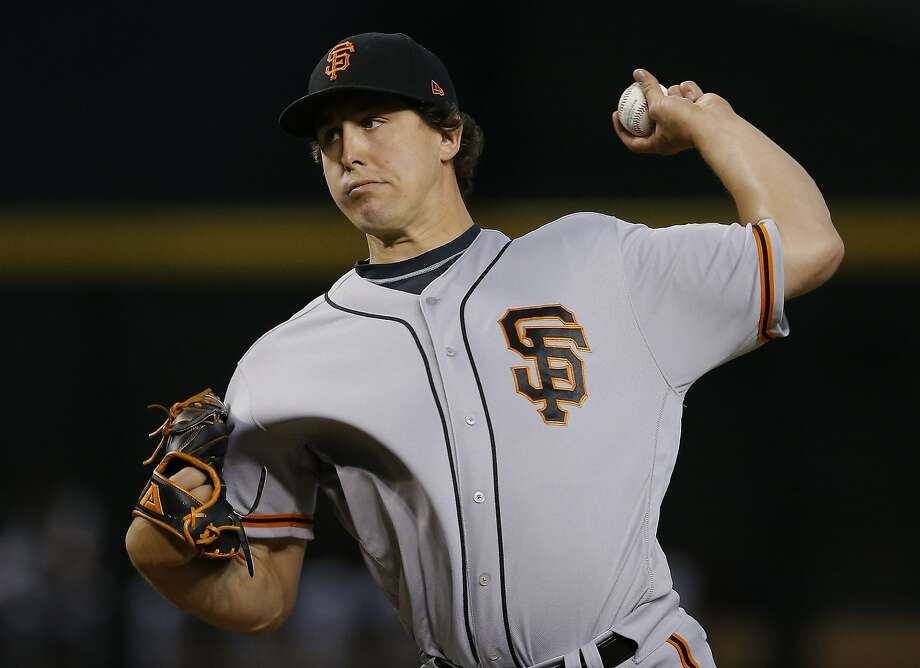 Derek Holland has been a valuable addition for the Giants. He also could be valuable to another team. Photo: Ross D. Franklin / Associated Press